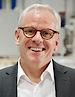 Chris Abbott's photo - CEO of BRUSH