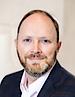 Jim Holm's photo - CEO of Examity