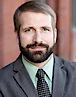 Dominik Mjartan's photo - CEO of Southern Bancorp Community Partners