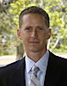Dr. Mac Powell's photo - President & CEO of JFKU