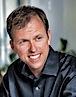John Ellis's photo - Chairman & CEO of Tapiture