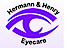 Volk Optical's Competitor - Hermann and Henry Eyecare logo