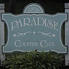 Paradise Country Club's Company logo