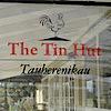 The Tin Hut Country Pub's Company logo